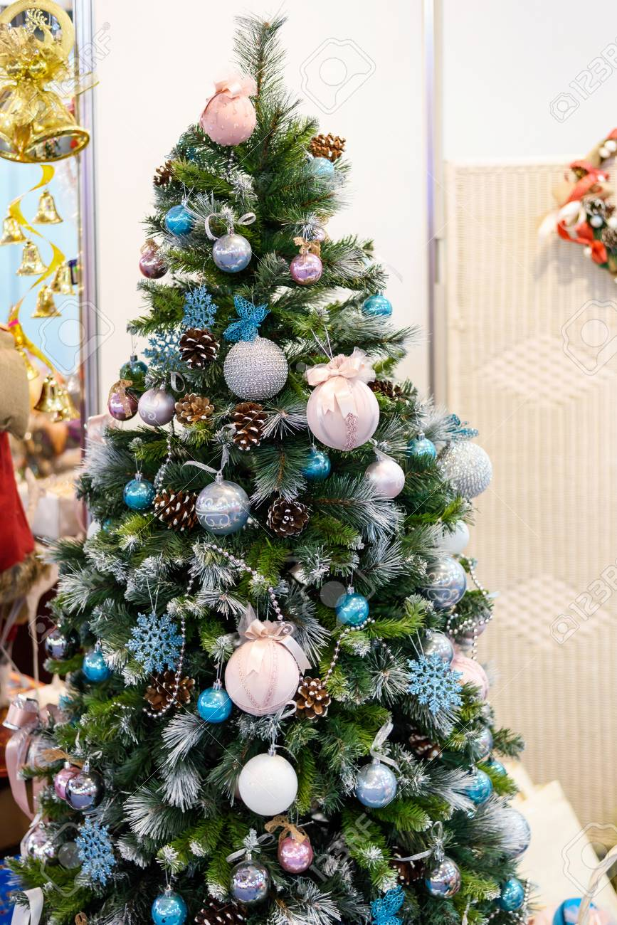 Christmas Tree With Colorful Ornaments Golden Bells Butterflies Stock Photo Picture And Royalty Free Image Image 68900819