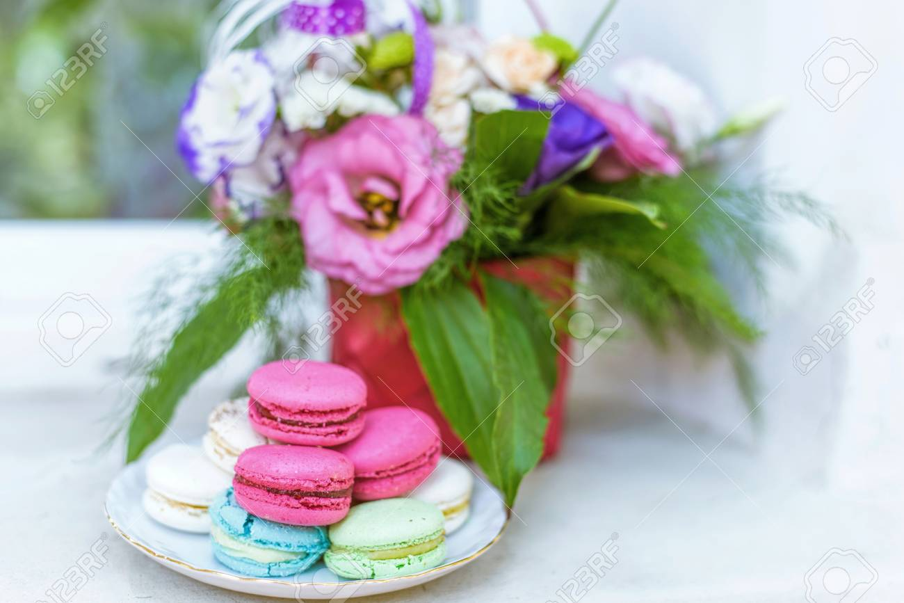 Summer flowers bouquet in a basket white red and purple pink stock photo summer flowers bouquet in a basket white red and purple pink and green macaroons sweets and candies on white plate izmirmasajfo