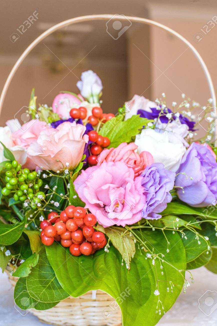 Summer Flowers Bouquet In A Basket White Red And Purple Stock