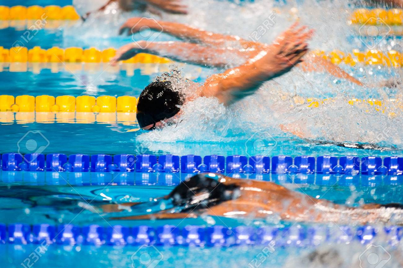 Exceptionnel Butterfly Men Swimming Race On Swimming Pool Stock Photo   35518264
