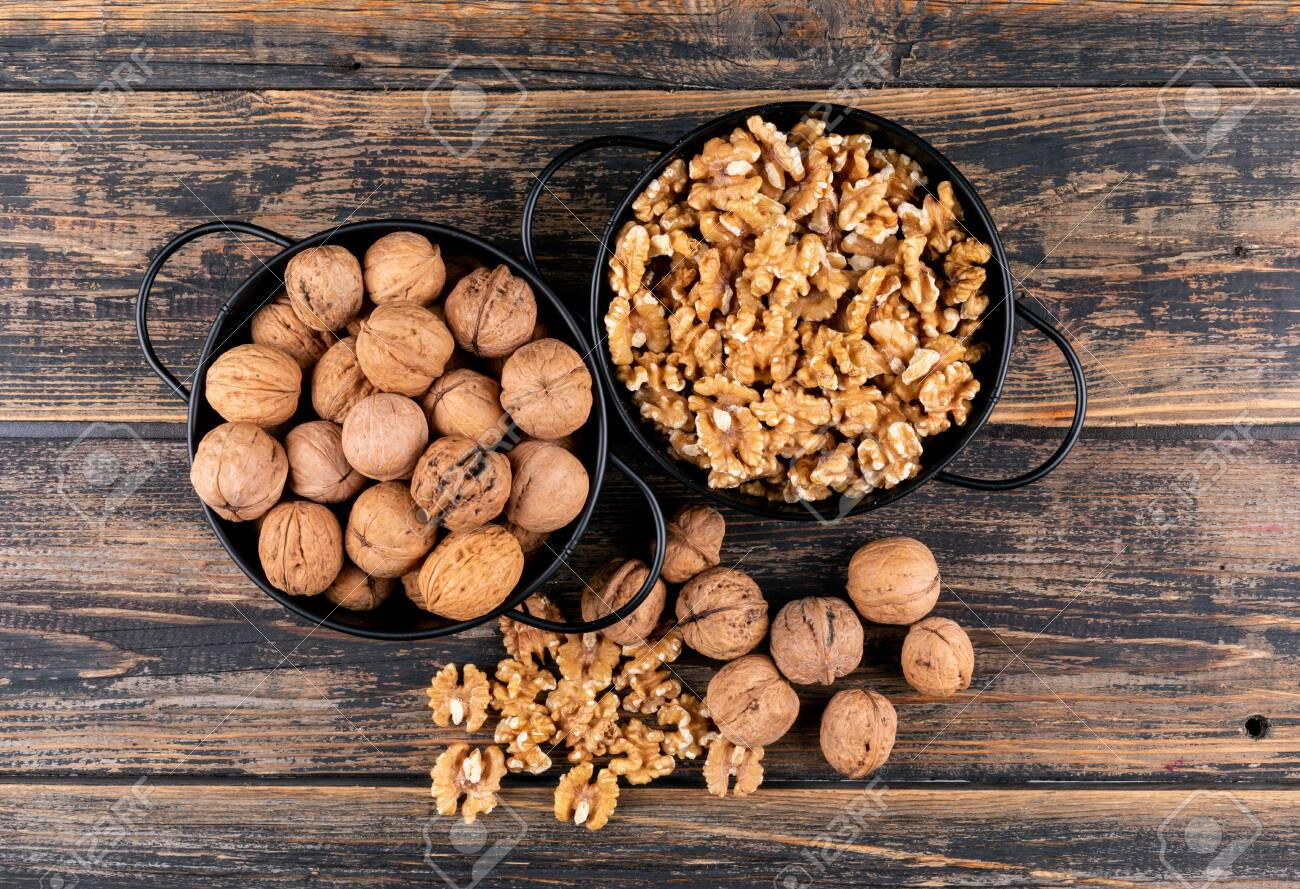 Top view walnuts in baskets on wooden background horizontal - 141443251