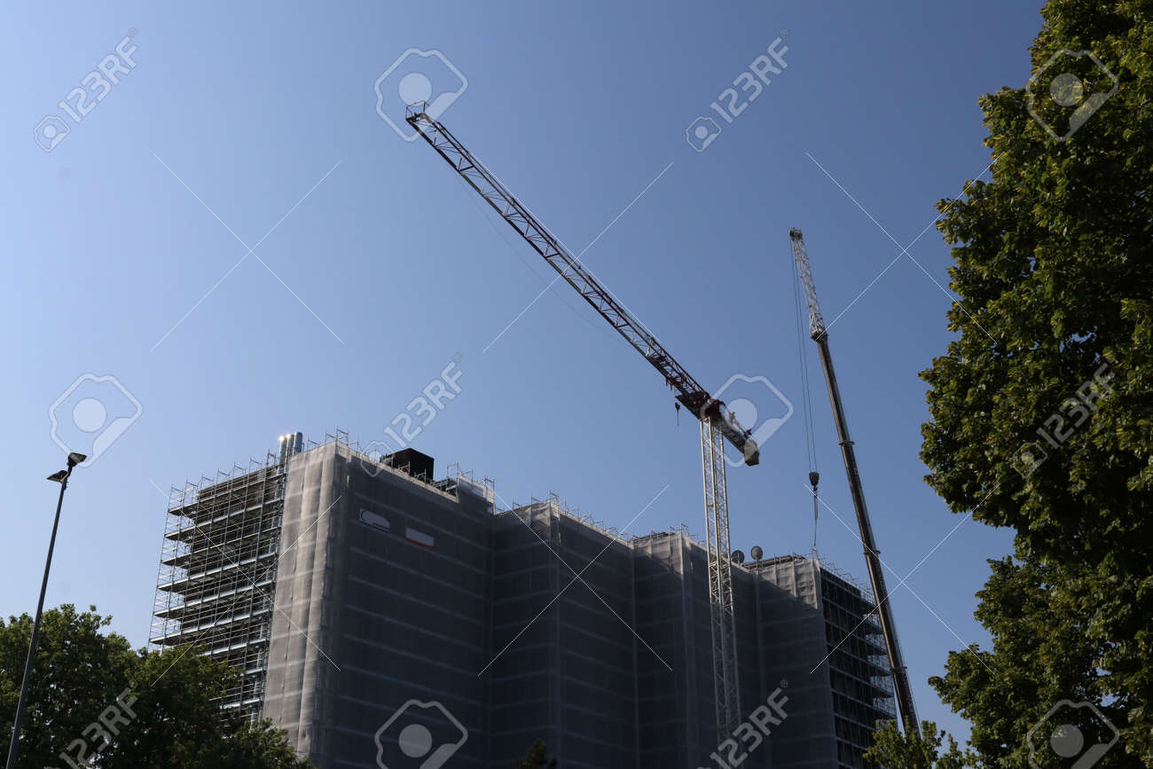 Building under renovation with roofs and cranes, Italy - 172808617