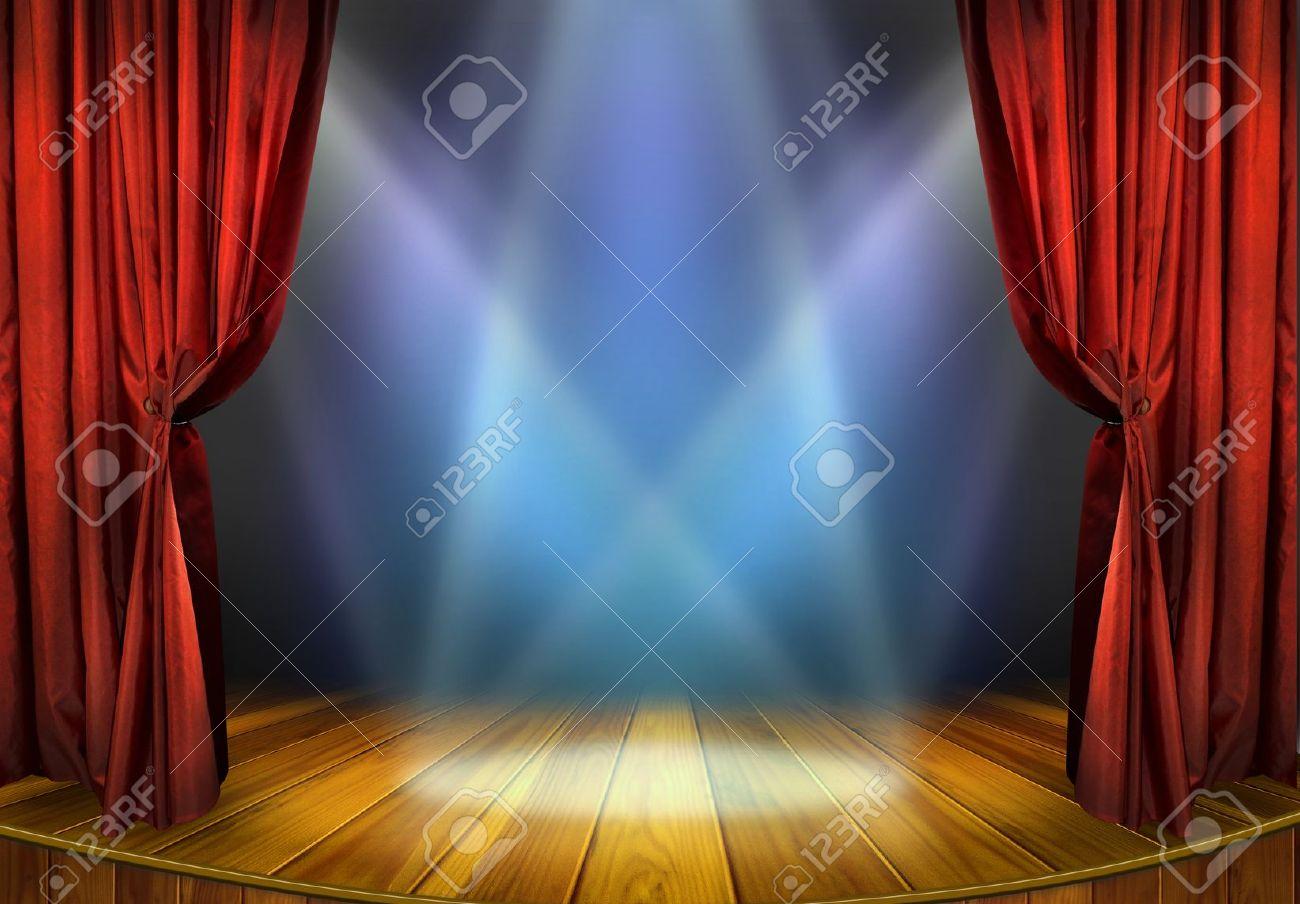 teatro escenario con cortinas rojas y la escena teatral focos a la luz de los reflectores