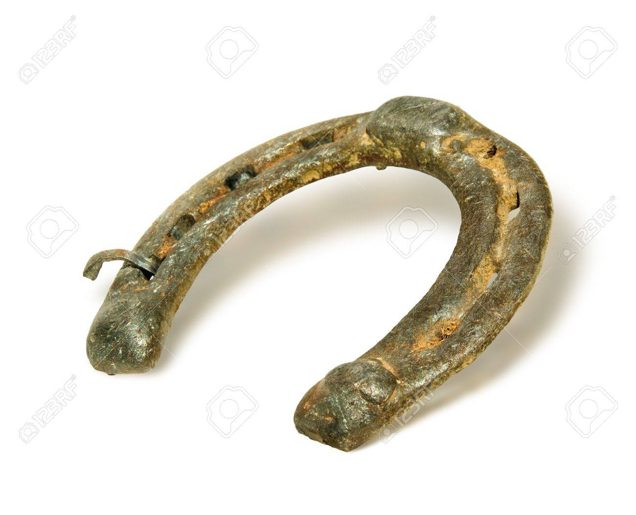 Old metal horseshoe isolated on white background ancient horseshoe old metal horseshoe isolated on white background ancient horseshoe a symbol of good luck stock biocorpaavc Choice Image