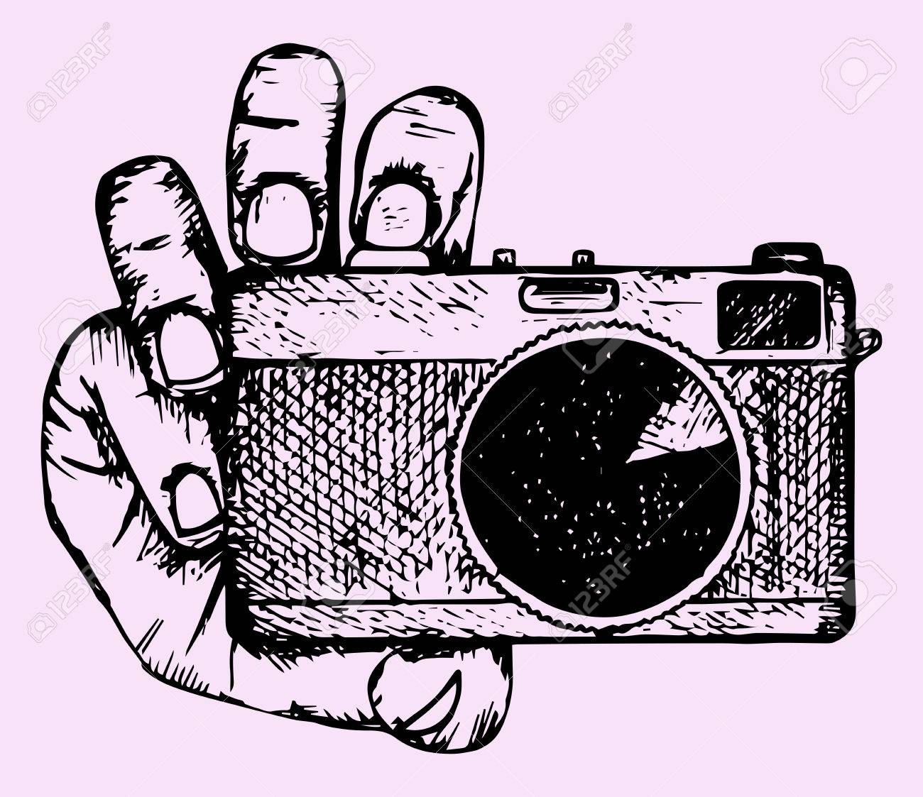 Camera in hand, doodle style, hand drawn - 50128251