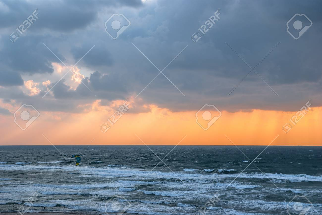 kitesurfing  and storm clouds over the sea Stock Photo - 13383576