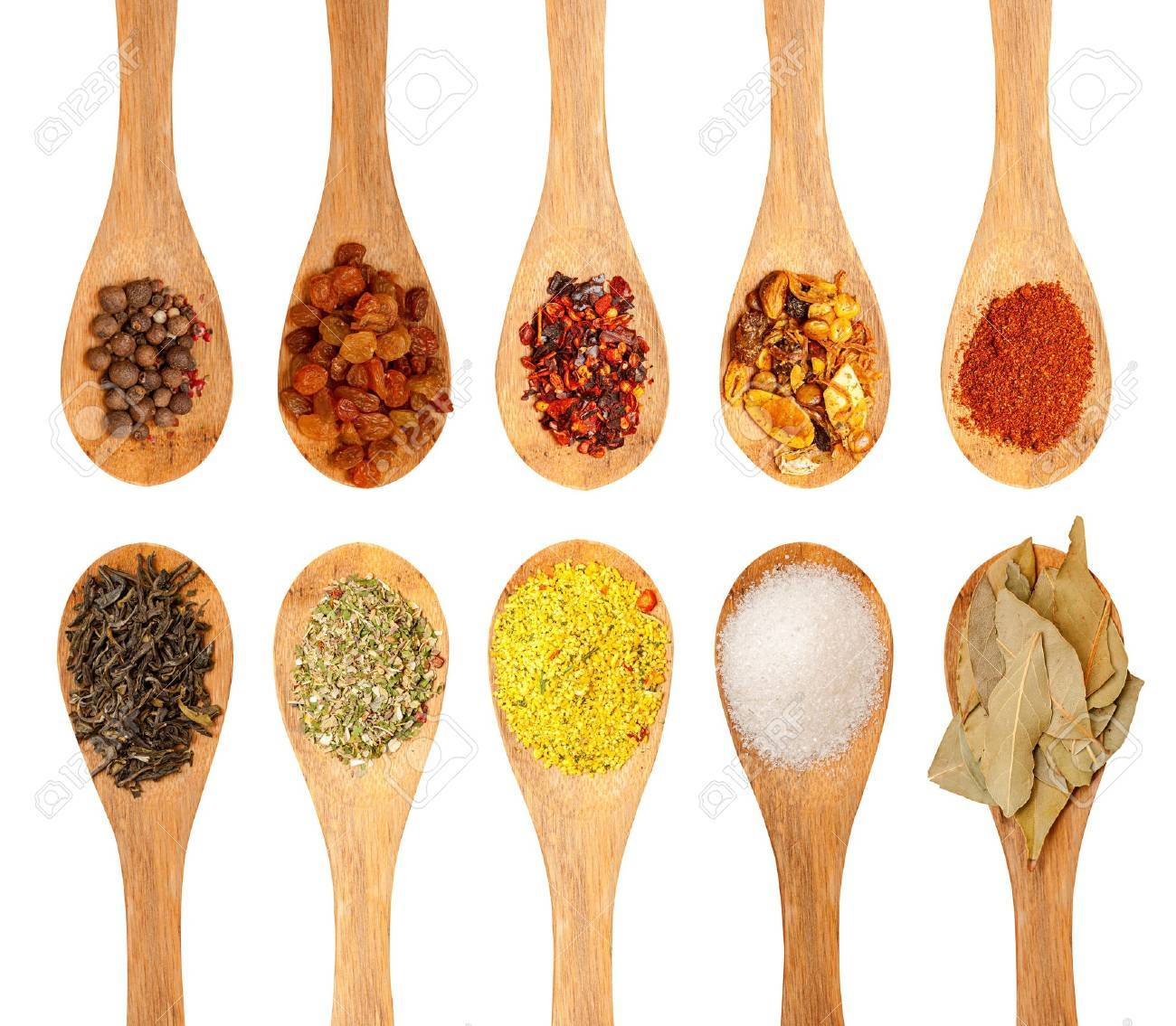 wooden spoons with seasonings on a white background, each one is shot separately Stock Photo - 17629421