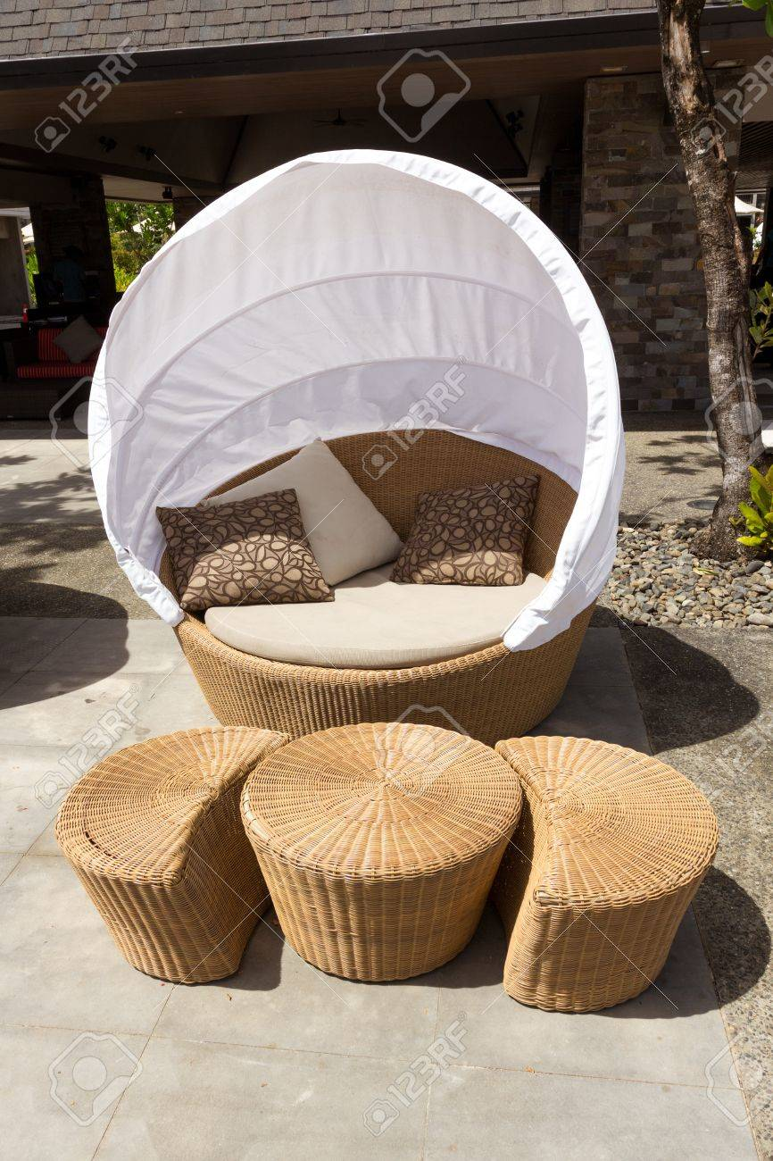 Bamboo Round Chair - Round sofa chair made from bamboo with white tent cover on outdoor patio stock photo