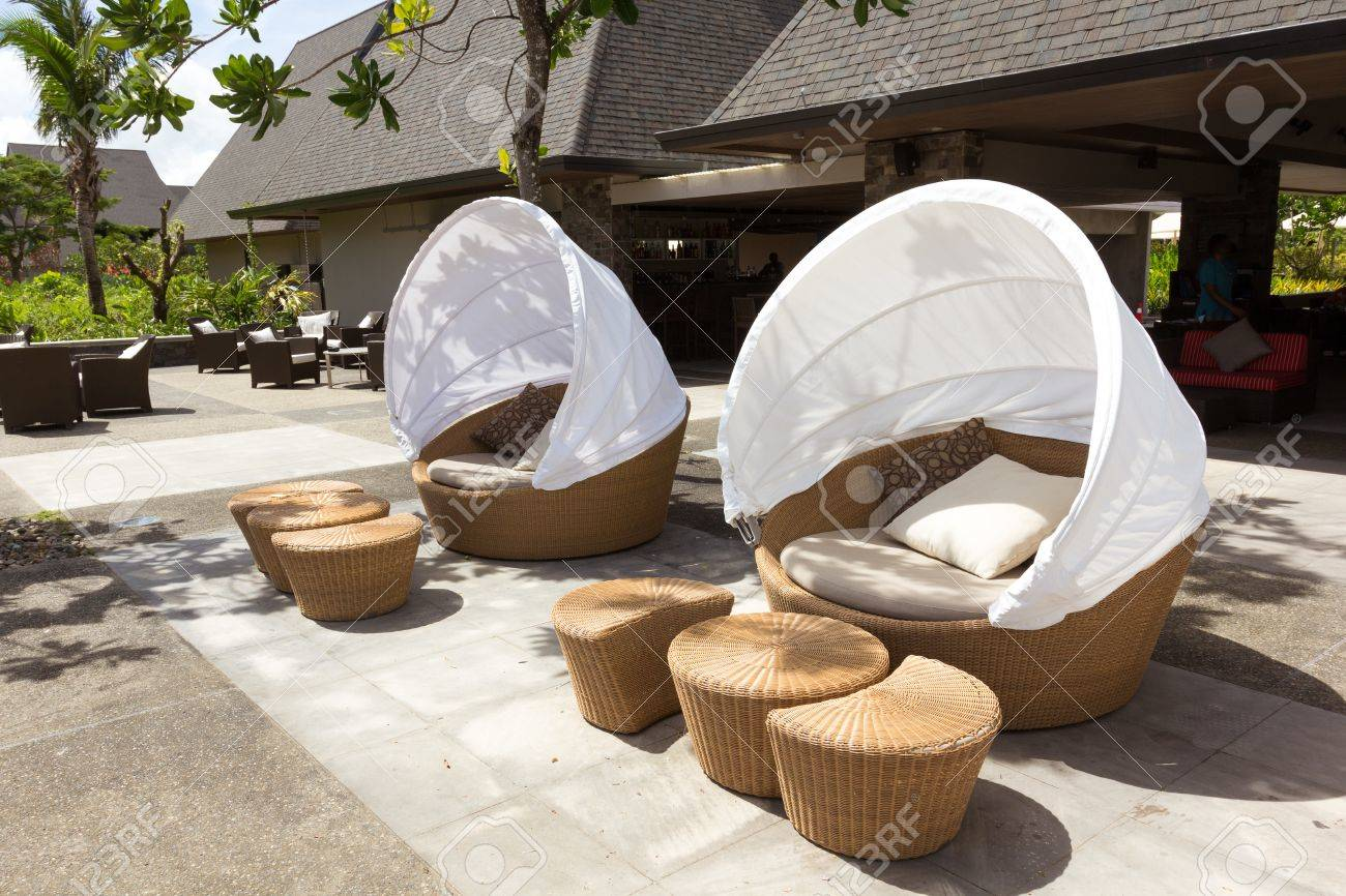 stock photo two round sofa chair made from bamboo with white tent cover on outdoor patio - Round Sofa Chair