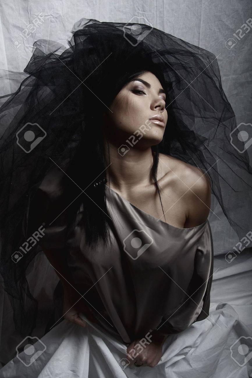 Under a veil of secrecy. Beautiful woman. Fashion art photo. Stock Photo - 5605157