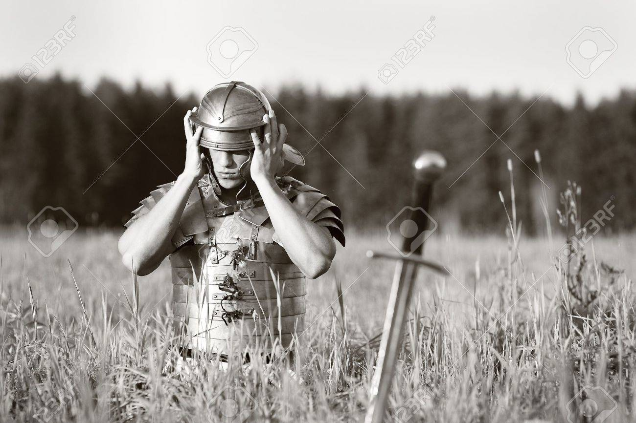 One Roman soldier in field. No war concept Stock Photo - 5632864