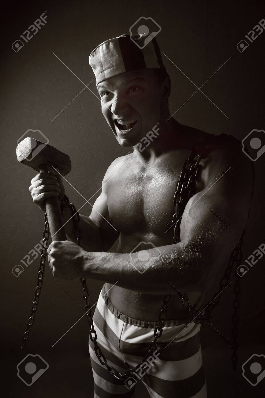 man of an athletic constitution in suit of prisoner. Stock Photo - 5776390