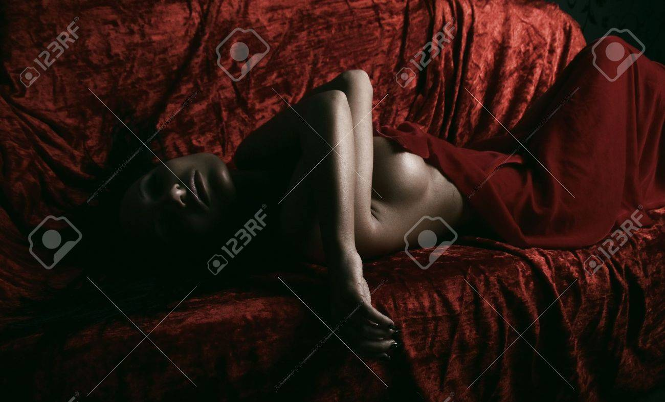 very sexy woman covered with red silk sheet Stock Photo - 5812957