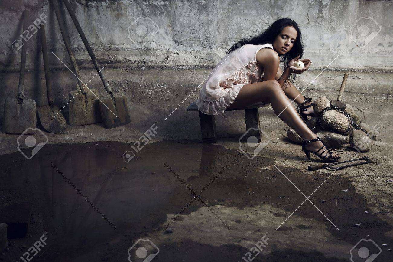 Attractive prisoner in a pink dress with billiard ball in hands. Vogue style photo. Stock Photo - 7395896