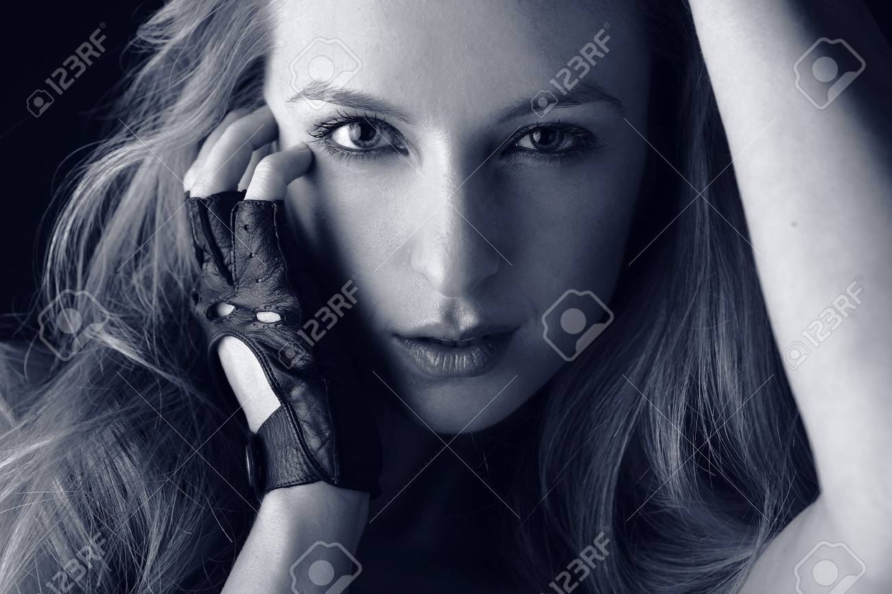 Portrait of attractive young blond girl in sports gloves. Blue toning. Stock Photo - 7549089