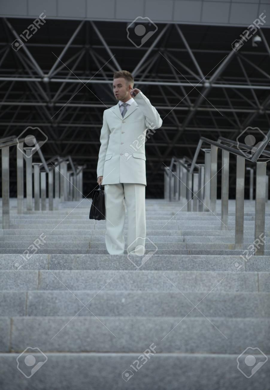 Businessman posing on stairs Stock Photo - 7874864