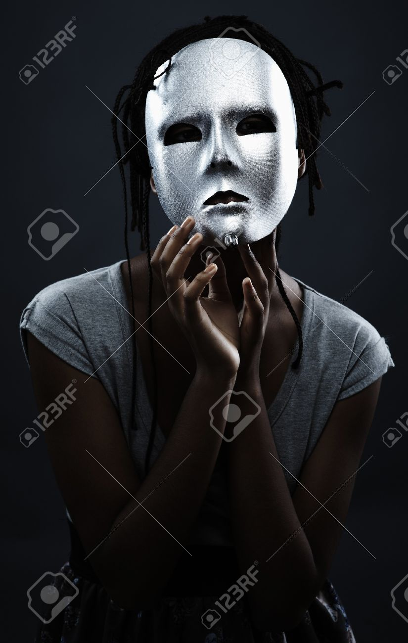 gloomy woman in silver mask posing on a black background. Stock Photo - 7874894