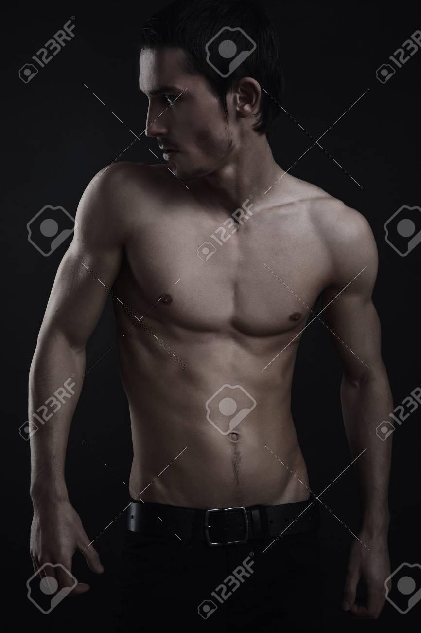 Beautiful athletic caucasian man on dark background Stock Photo - 8201362