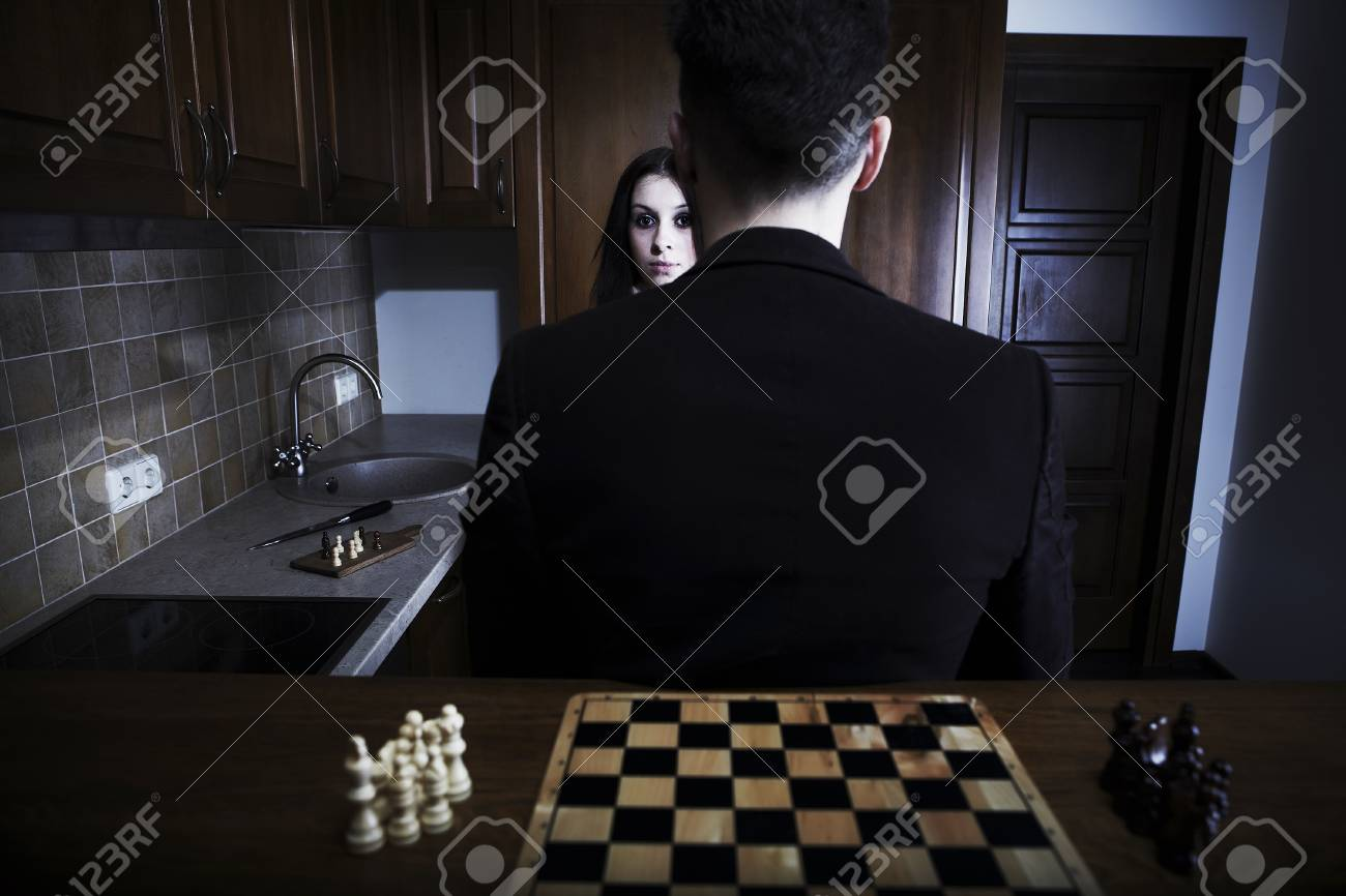Men sitting back against a chessboard Stock Photo - 8596639