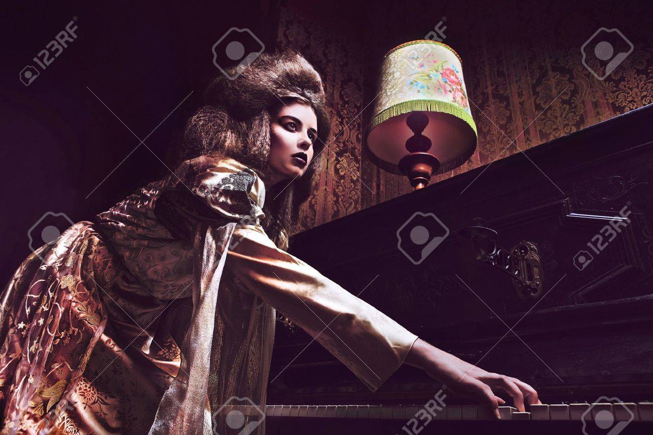 Gloomy duchess with mask  Vogue style vintage portrait in luxury interior Stock Photo - 12960641