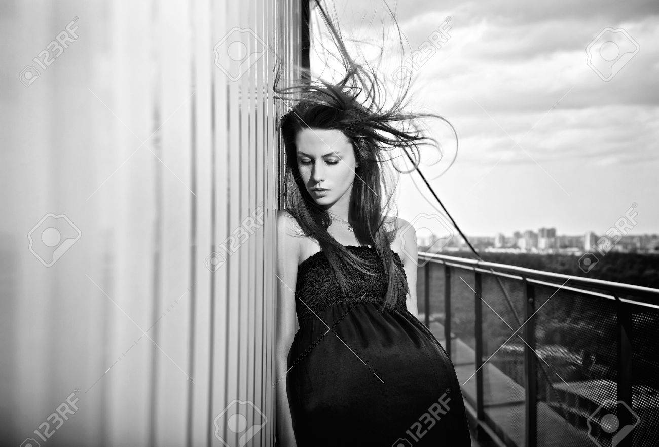 Young sensual   beauty woman in a fashionable dress Stock Photo - 12962002