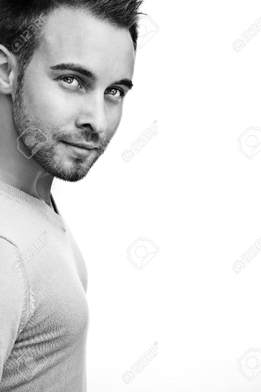 Attractive man wearing sweater close up portrait on white background stock photo 12962293