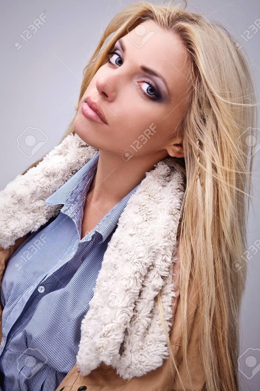 Amazing beautiful blond woman on fur Stock Photo - 15598760