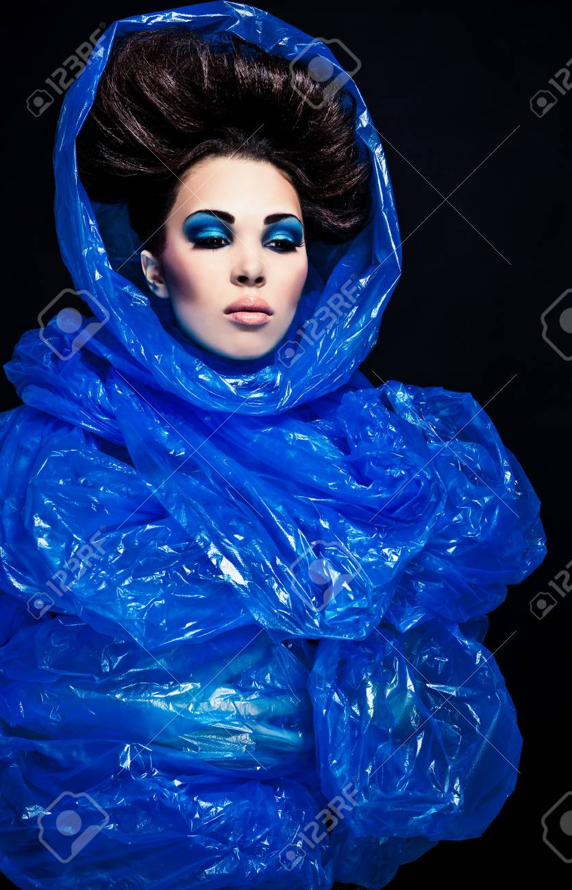 Futuristic beautiful young female face with blue fashion make-up Stock Photo - 15587837