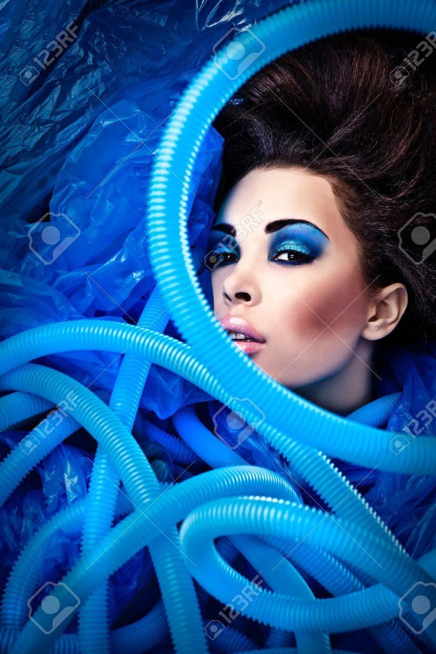 Futuristic beautiful young female face with blue fashion make-up Stock Photo - 15587879