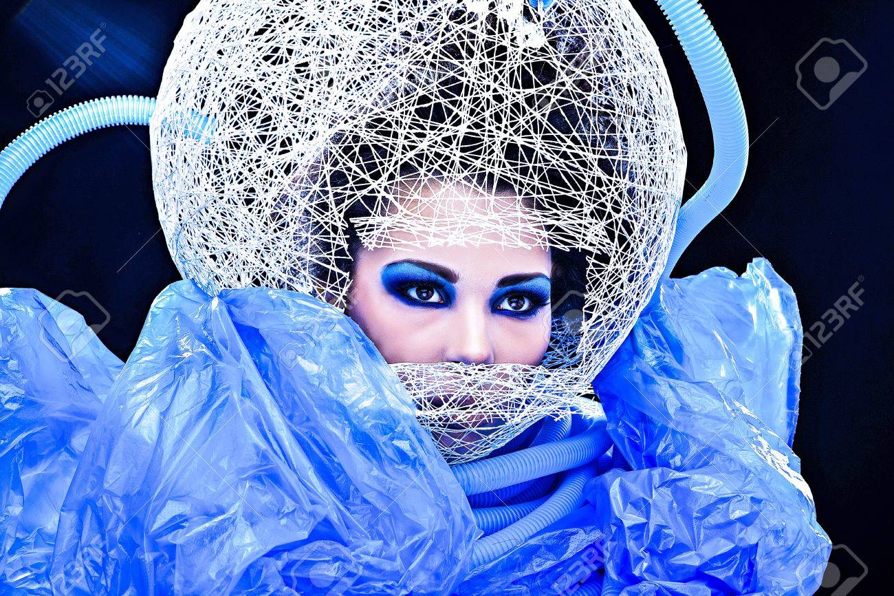 Futuristic beautiful young female face with blue fashion make-up Stock Photo - 15587985