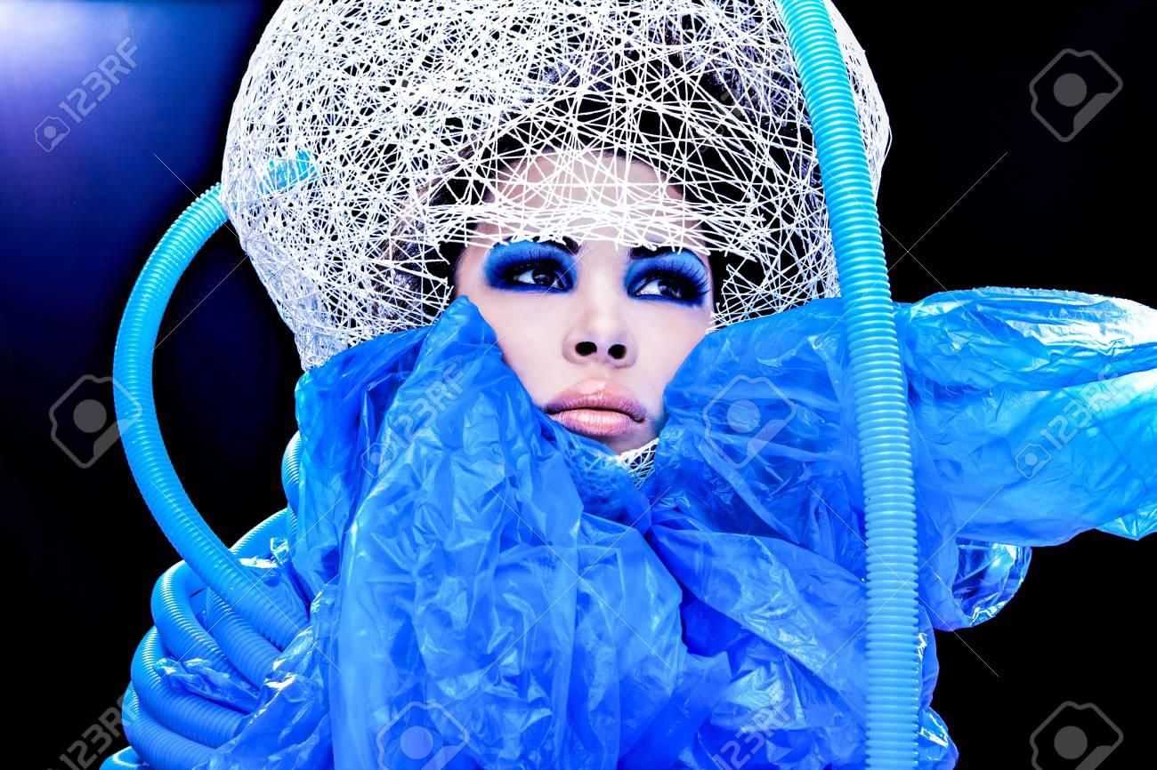 Futuristic beautiful young female face with blue fashion make-up Stock Photo - 15587994