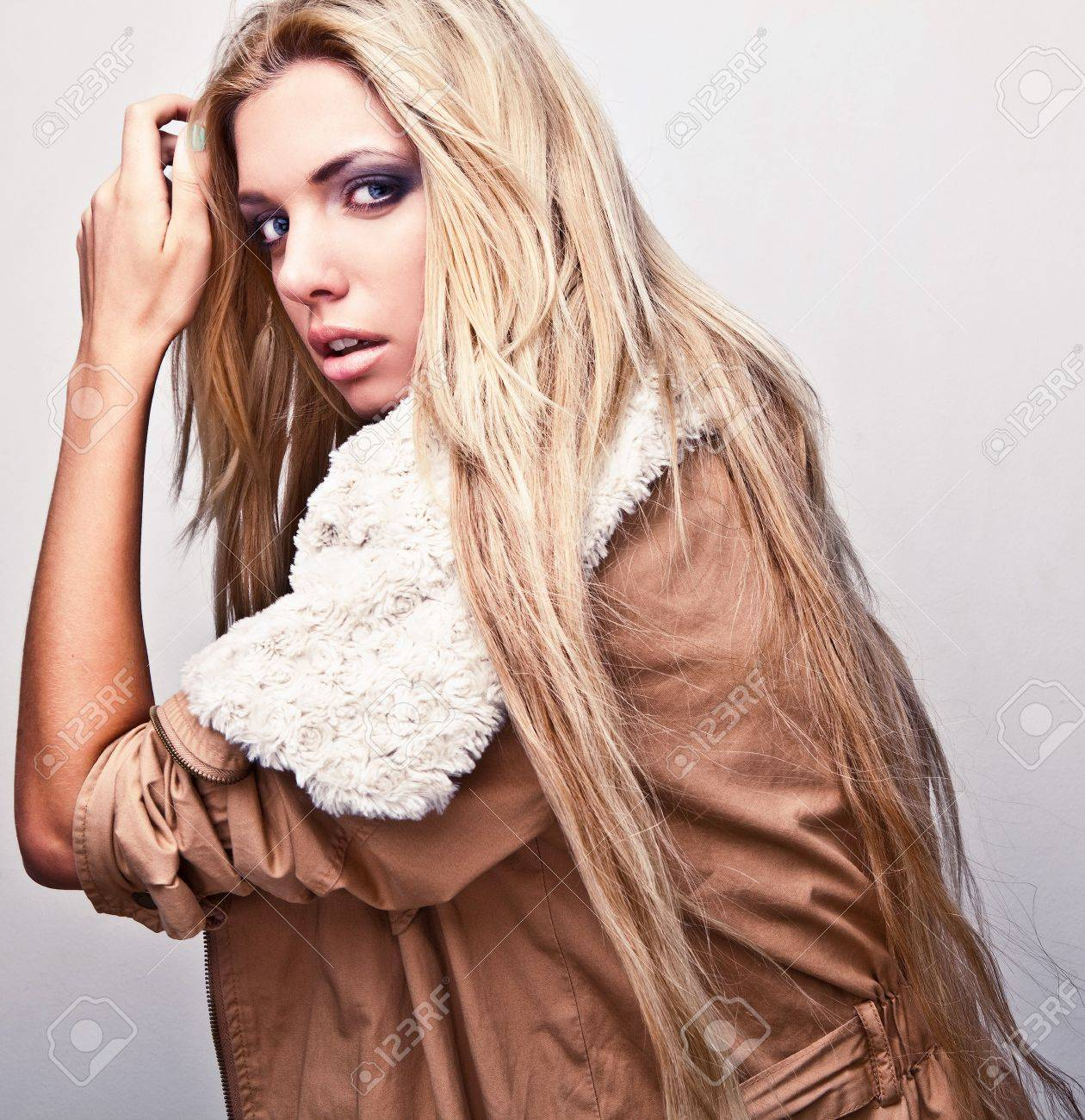 Amazing portrait of beautiful young blond woman on fur Stock Photo - 15575334