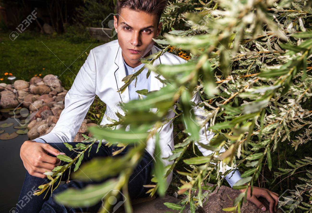 Portrait of young beautiful fashionable man against autumn garden Stock Photo - 15576936