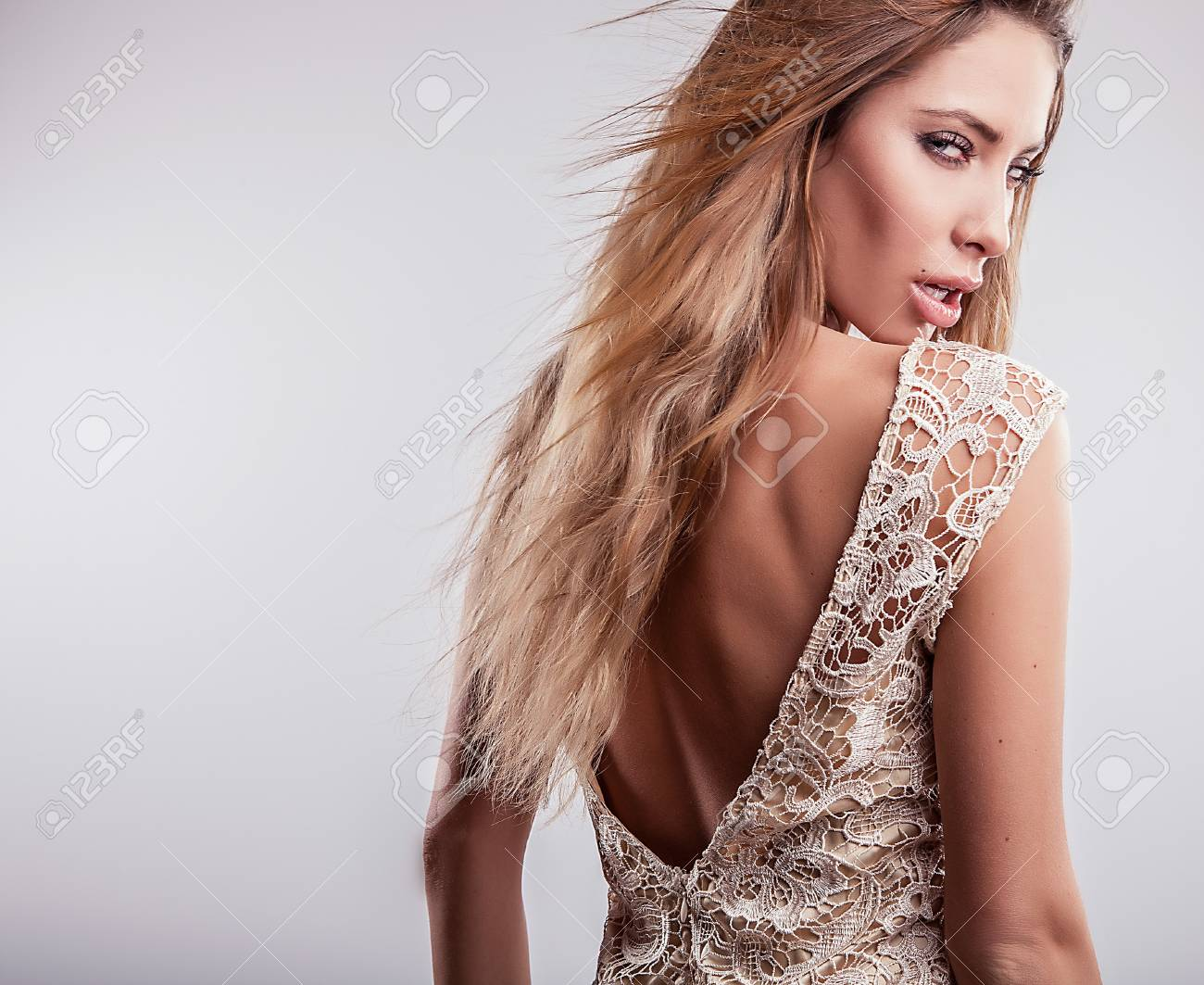 Young sensual model girl pose in studio Stock Photo - 17130095