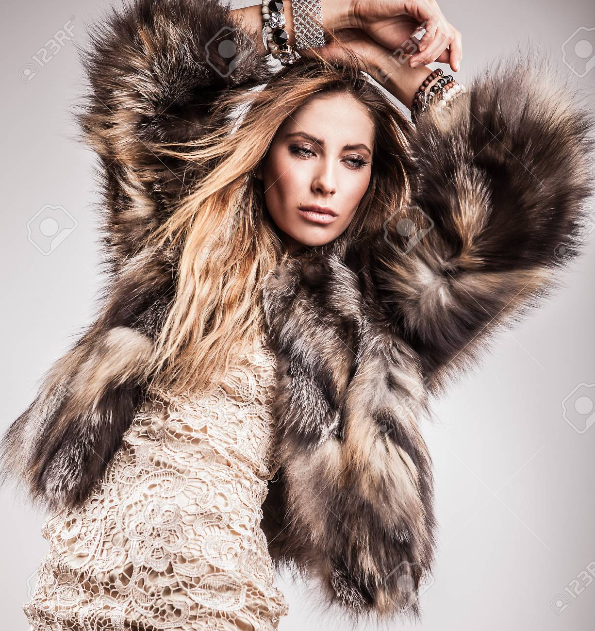 Portrait of attractive stylish woman in fur against grey background Stock Photo - 17104646