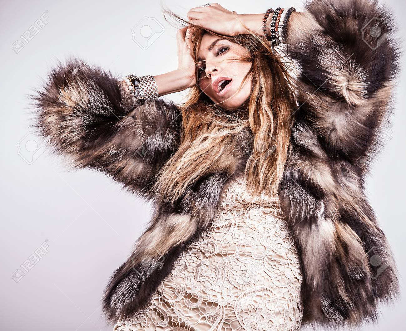 Portrait of attractive stylish woman in fur against grey background Stock Photo - 17104625