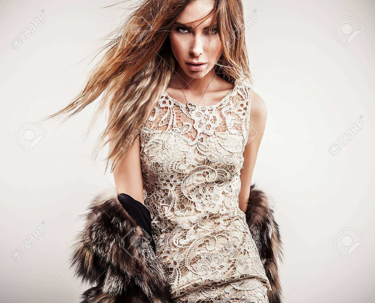 Portrait of attractive stylish woman in fur against grey background Stock Photo - 17130097