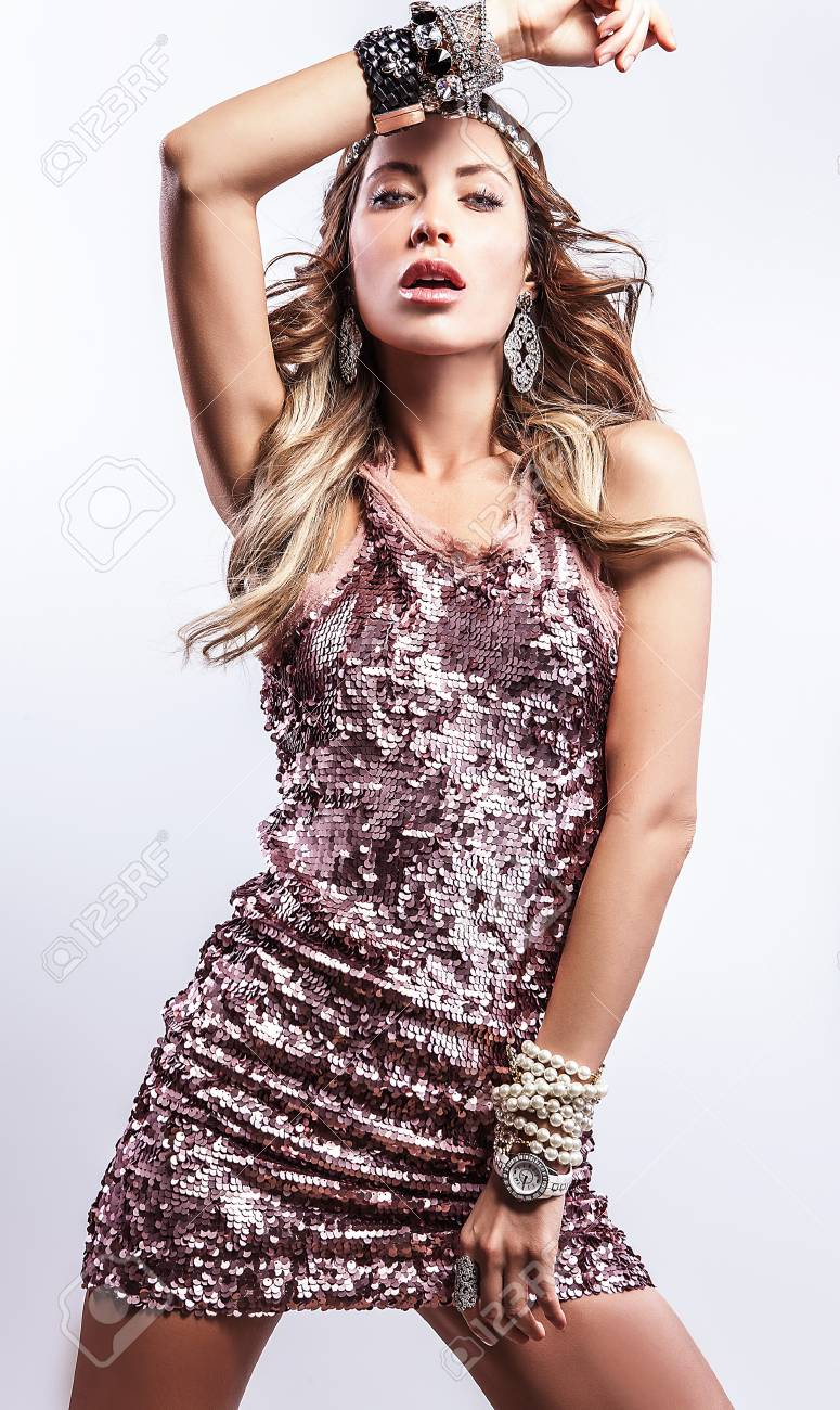 Young sensual   beauty woman in a fashionable dress Stock Photo - 17104552
