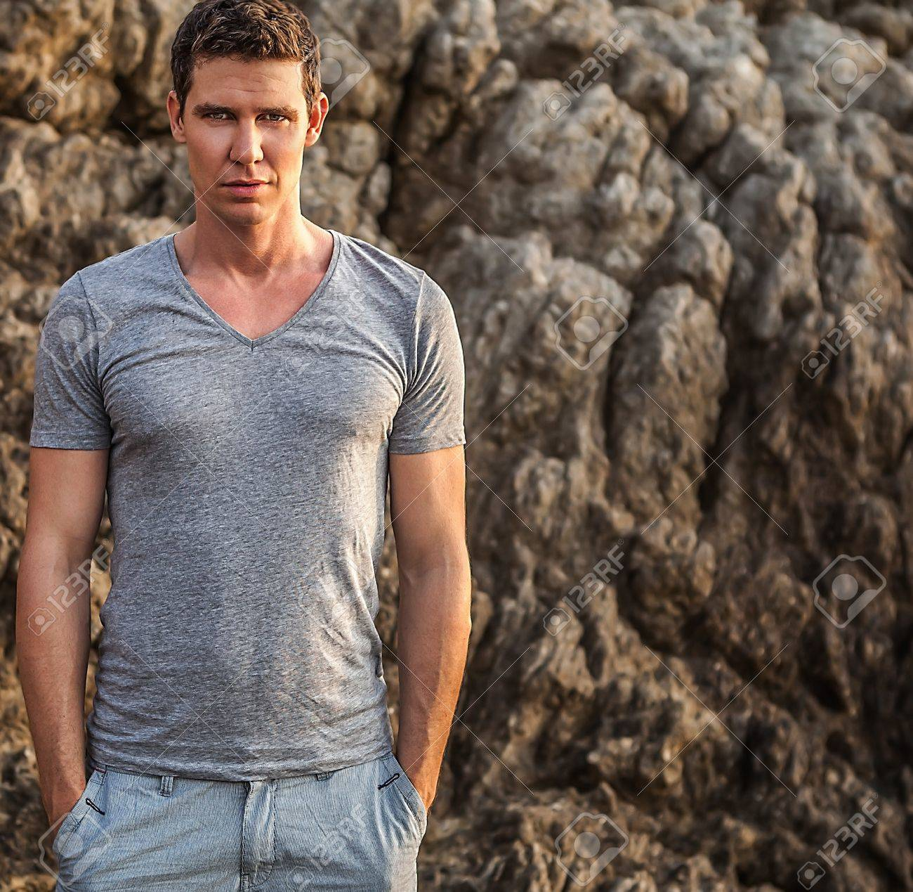 Portrait of adult handsome man against rock background Stock Photo - 19119694