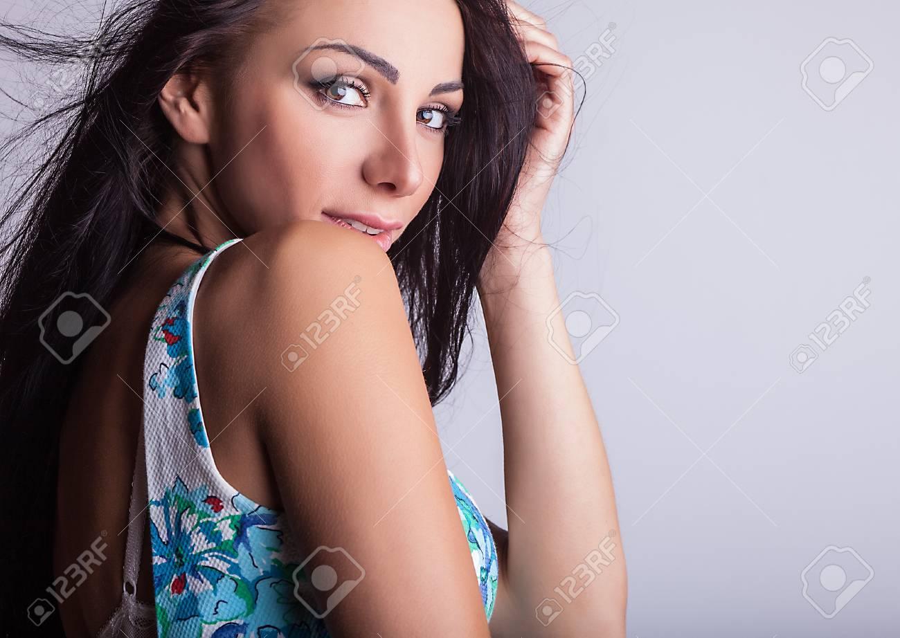 Attractive friendly brunette pose in studio Stock Photo - 20054594