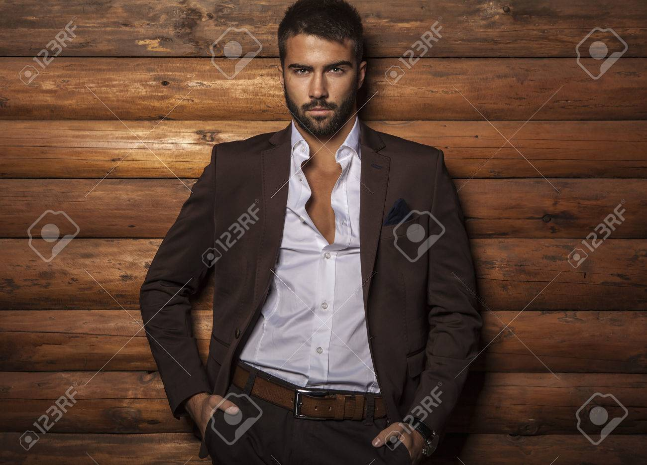 Portrait of young beautiful fashionable man against wooden wall Banque d'images - 22572461