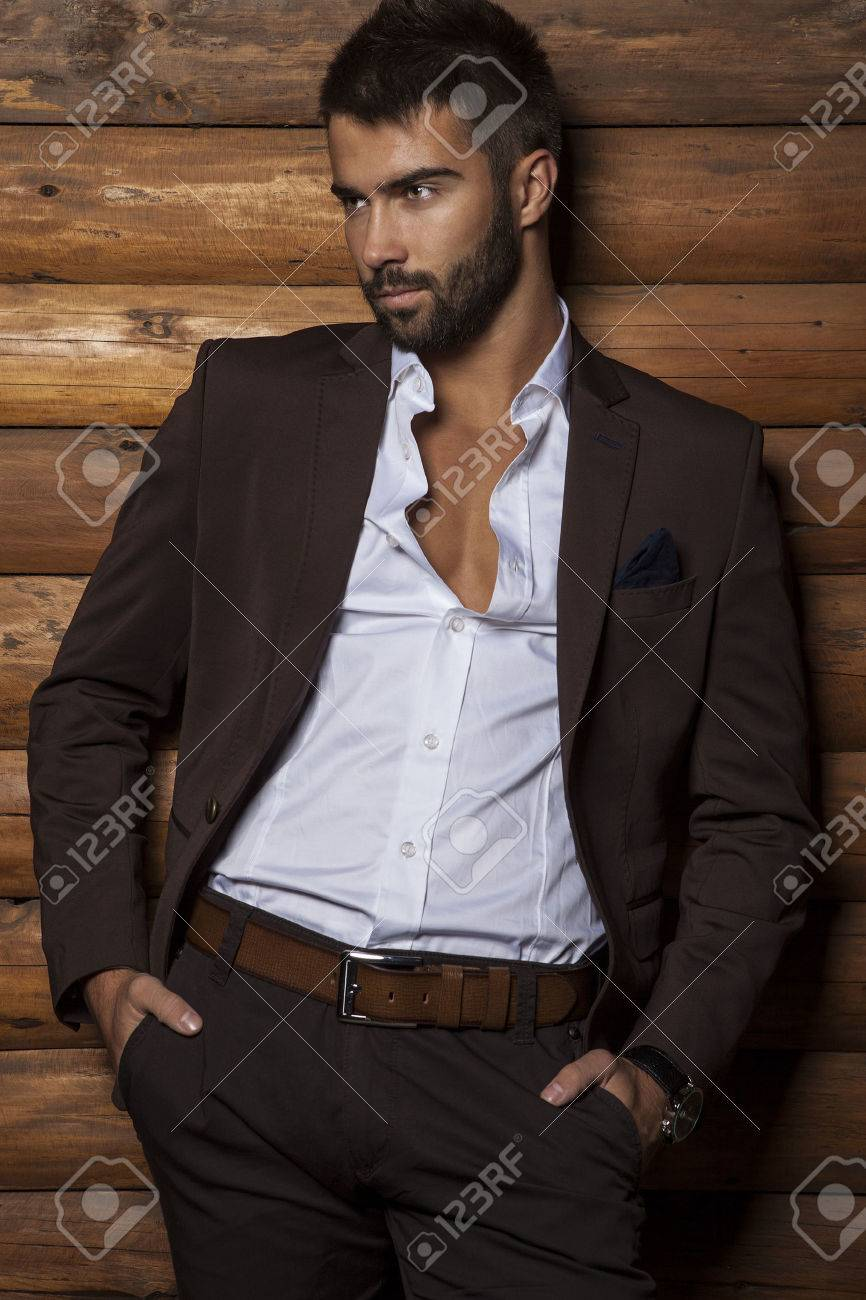 Portrait of young beautiful fashionable man against wooden wall Banque d'images - 24368231