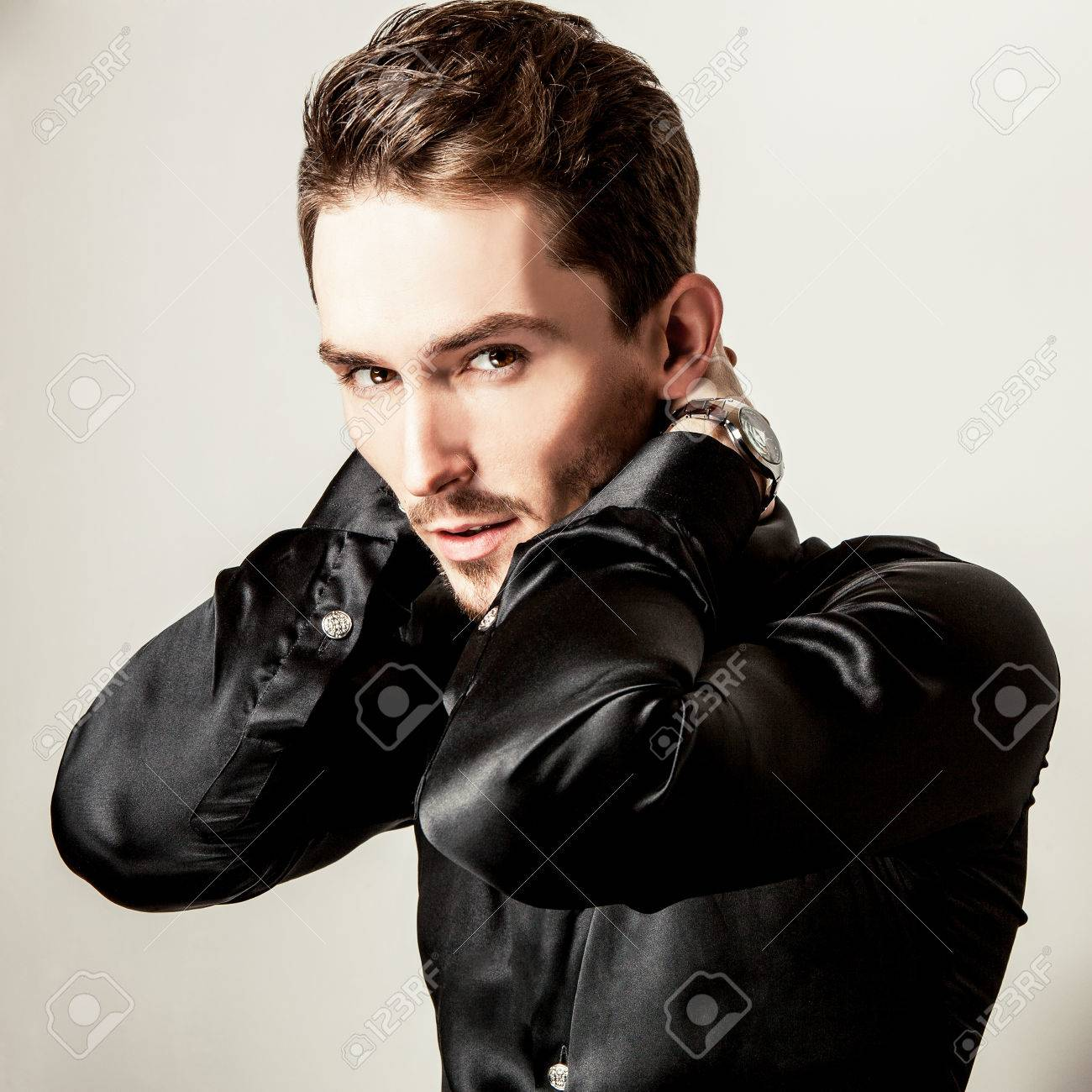 Elegant young handsome man in black silk shirt. Studio fashion portrait. Banque d'images - 36100186