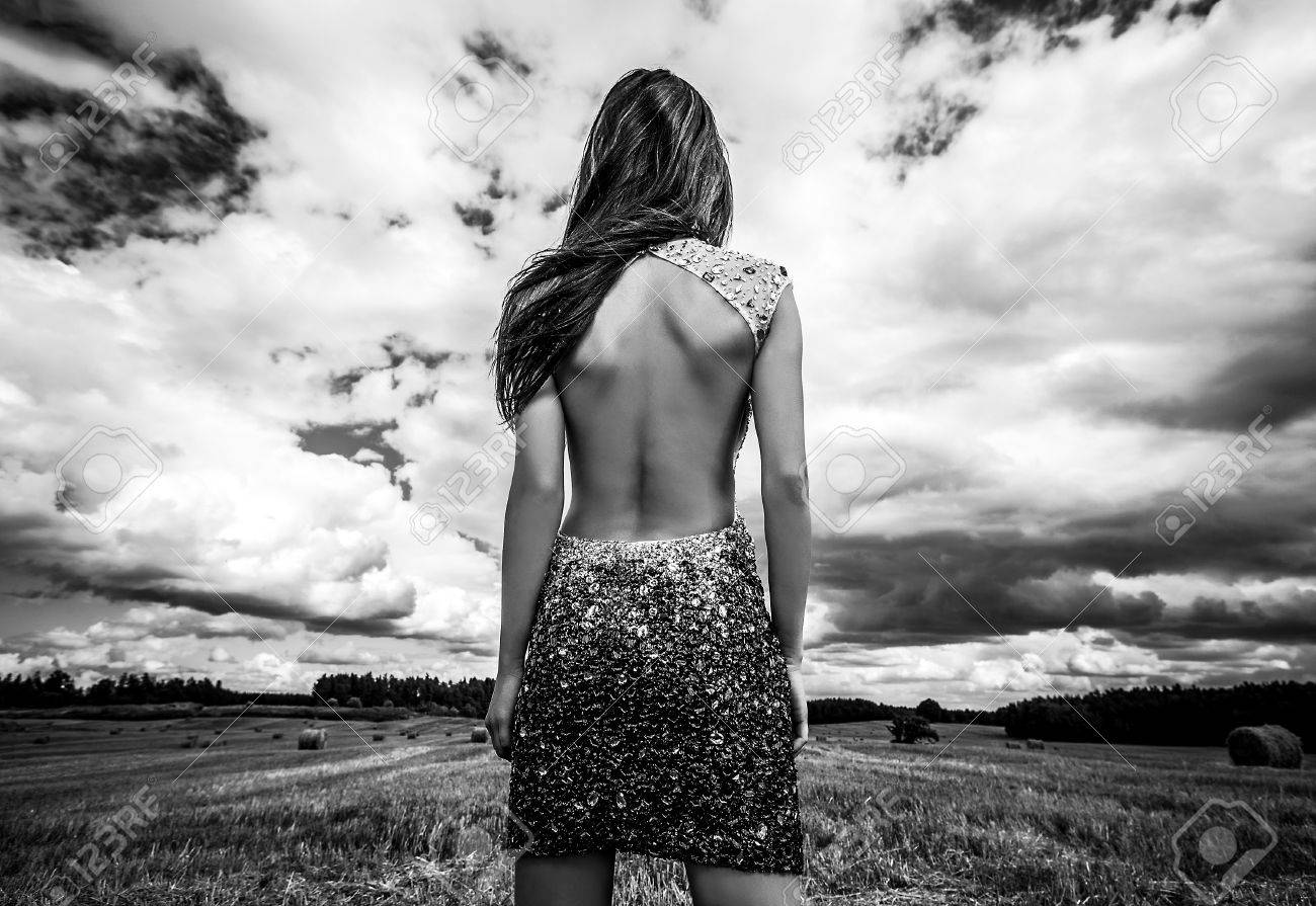 Stock photo young sensual beauty woman in a fashionable dress pose outdoor black white photo