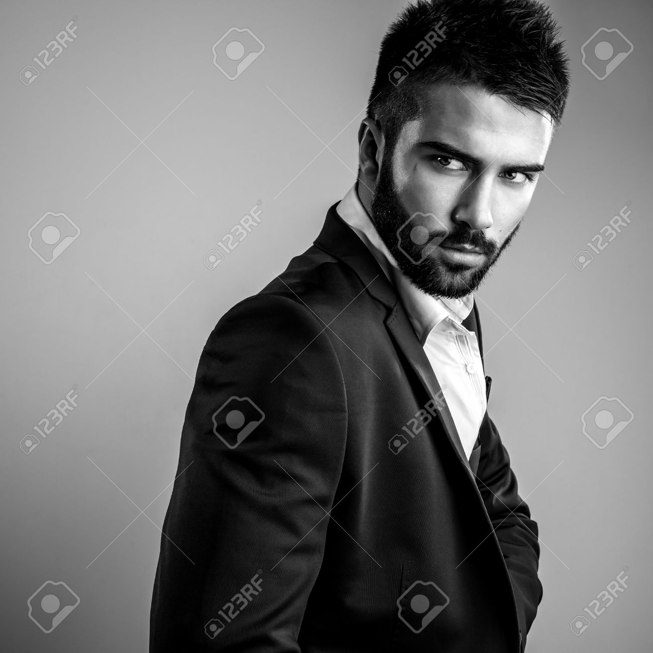 Elegant young handsome man black white studio fashion portrait