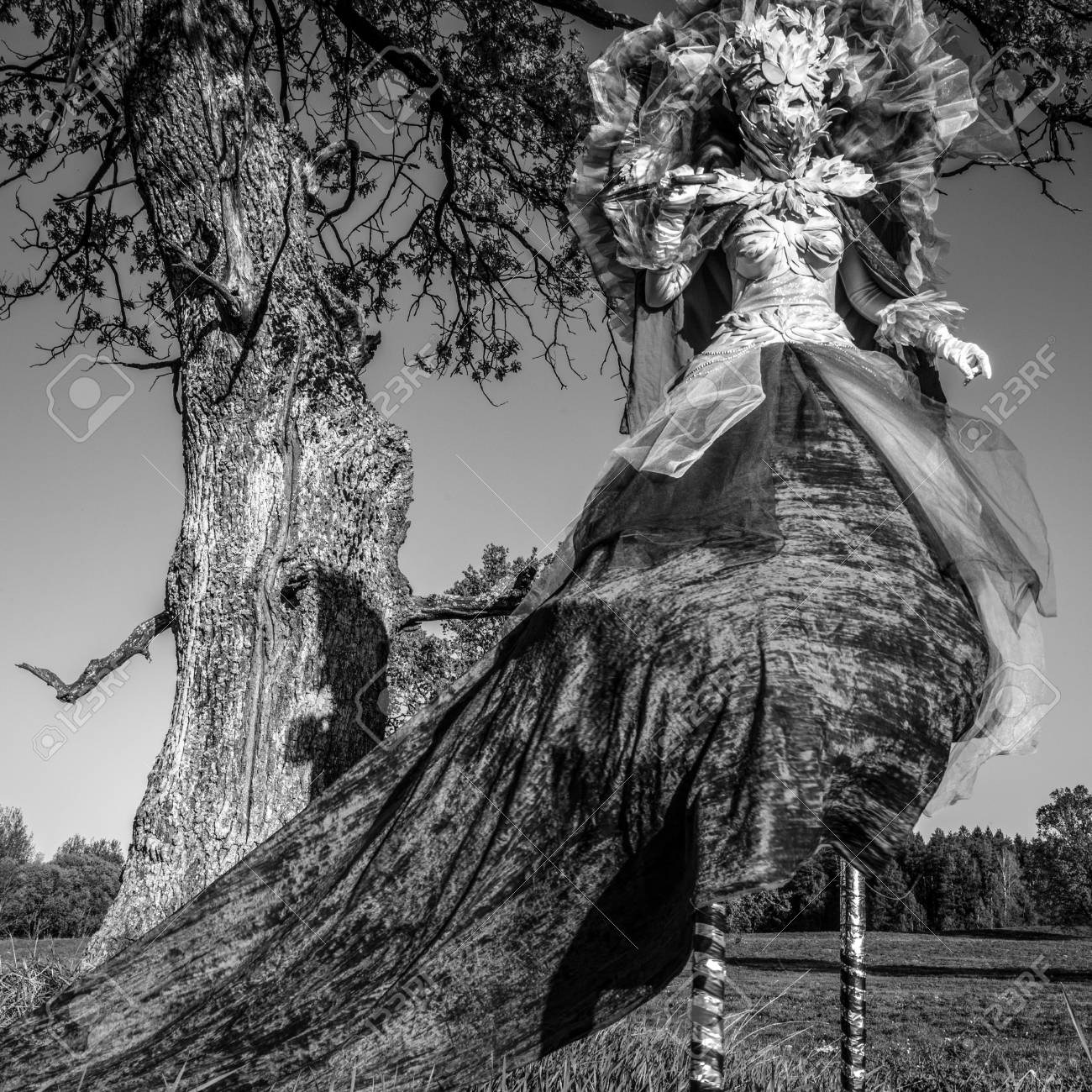 Fairy tale woman on stilts in fantasy stylization fine art black white photo