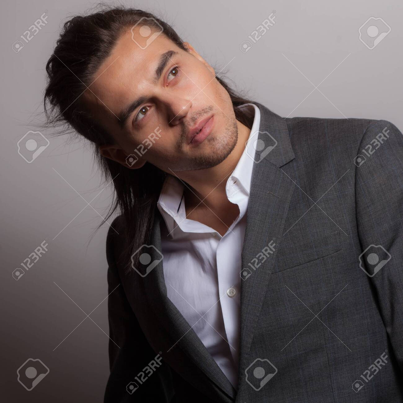 Handsome young elegant man studio portrait. - 139643041