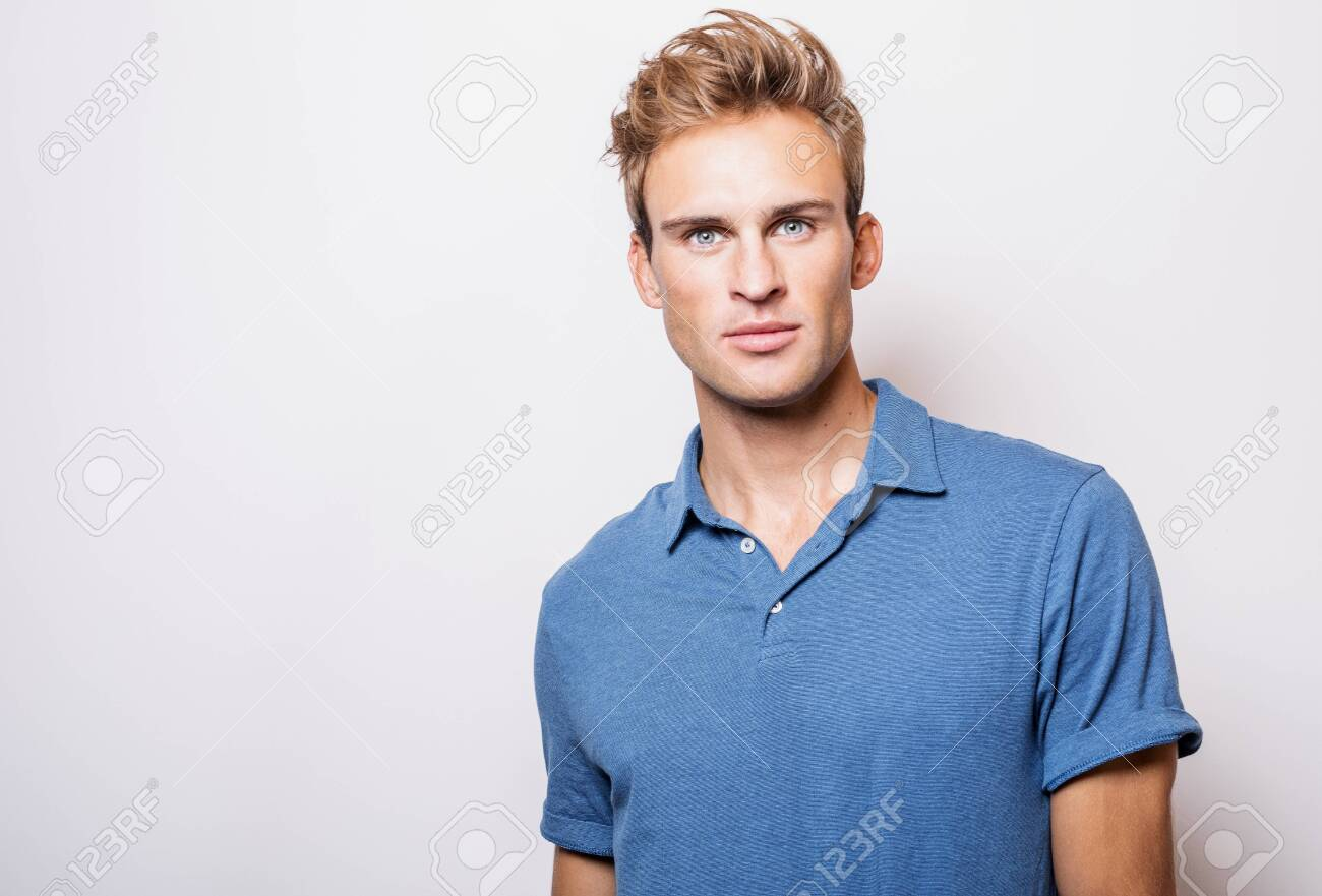 Elegant young handsome man in stylish blue shirt. - 143277804