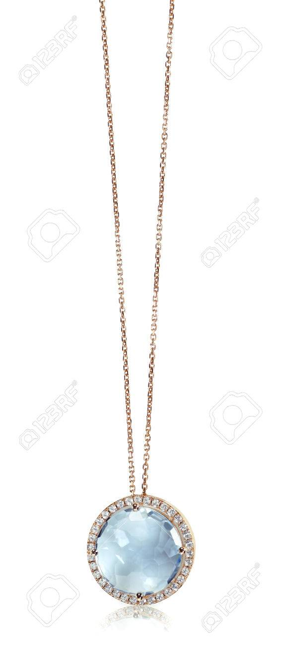 Blue gemstone and diamond pendant necklace isolated on a white blue gemstone and diamond pendant necklace isolated on a white background with a reflection stock photo aloadofball Image collections