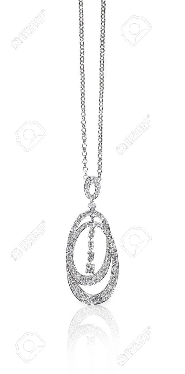 A beautiful diamond and gold pendant dangles from a chain fine a beautiful diamond and gold pendant dangles from a chain fine jewelry necklace isolated on aloadofball Gallery